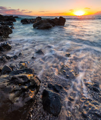 Water flow over coastal rocks on Maui