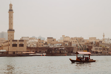 Excursion touristic boats on the Dubai Creek near old town Al Fahidi district