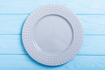 Empty gray plate on wooden table