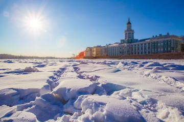 Saint Petersburg. Winter. Neva River. Museum of the Kunstkamera in St. Petersburg. Neva River in the ice. Sunny day in winter. Russia. Architecture of Petersburg.