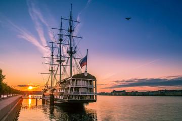 Saint Petersburg. Dawn. Morning in Petersburg. Sailboat on the Neva River. Embankment of the Neva River. Russia. Rivers and canals in Petersburg.
