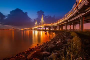 Saint Petersburg. The road goes to the bridge. Bridges of St. Petersburg. Highways on high piers. Highway. Russia. The Gulf of Finland. Krestovsky Island.