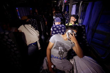 Hondurans are seen inside a bus bound for San Pedro Sula after being sent back by Guatemalan authorities for crossing illegally in their bid to join a migrant caravan heading to the U.S., in Ocotepeque