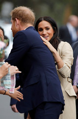 Britain's Prince Harry and his wife, Meghan, Duchess of Sussex, meet members of the public at the Royal Botanic Gardens in Melbourne
