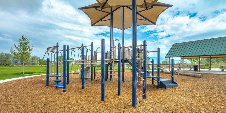 Childrens playground under cloudy sky in Lehi Utah