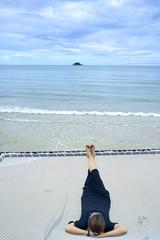 Women relaxing on the beach in weekend