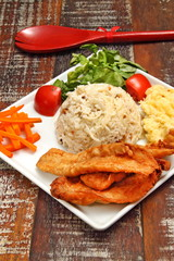 Fried fish with risotto and salad