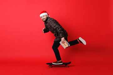 Man delivering Christmas gifts and looking at camera