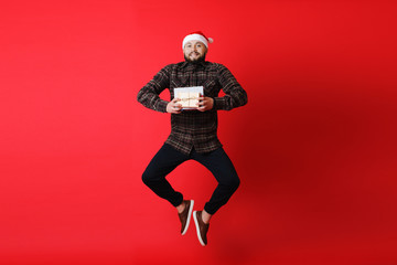 Man jumping with Christmas gifts
