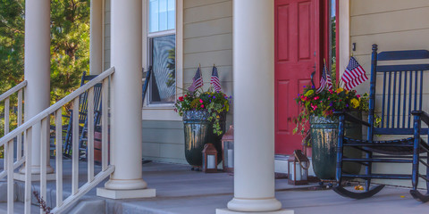 Front porch with stairs red door and rocking chair