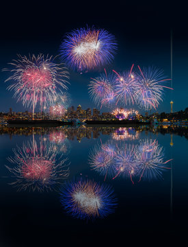 Seattle skyline and fireworks with reflections