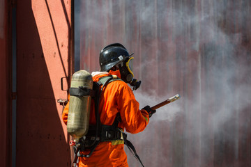 Firefighters holding ax / Fire and rescue training school regularly to get ready