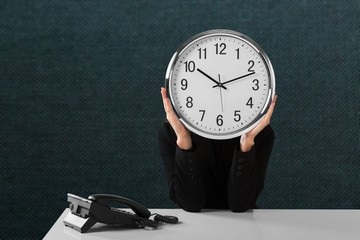Businessman holding Clock at head, Business Clock Concept