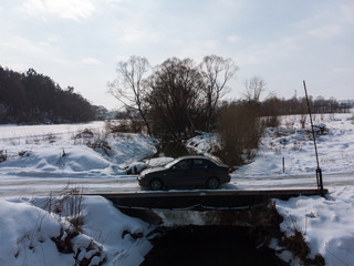car drive on bridge cross river. overtop view