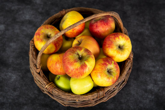 basket with red and yellow apples