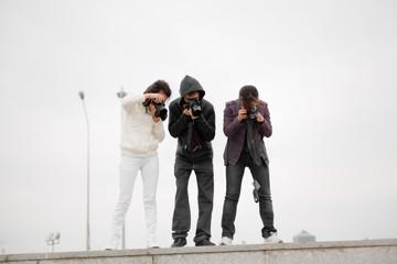 Paparazzi taking capture. People photographers