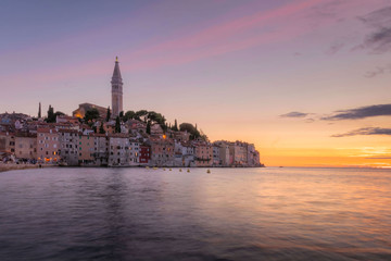 Fantastic summer sunset of Rovinj town, Croatian fishing port on the west coast of the Istrian peninsula. Colorful evening seascape of Adriatic Sea.