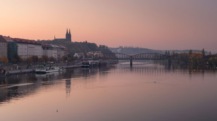 Autumn morning. Misty Vysehrad church and reflection of railway bridge. Prague, Czech republic