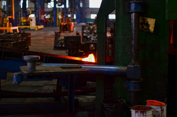 High precision hot forging product, automotive part production by hot forging process, automatice line hot forging. Iron melting recycling work. Heavy industry metallurgical plant sparks stove metall
