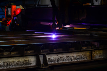 Cutting metal with plasma equipment. Metallurgical production, manufacturing premises, workshop at the plant, blast furnace, heavy industry, engineering, steelmaking