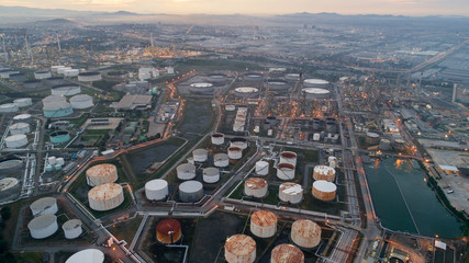 Aerial view gas storage sphere tanks in oil and gas refinery plant during sun rise morning time