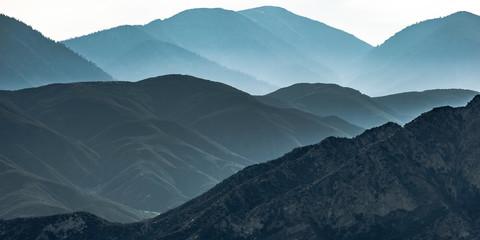 Vast mountain ridge in Ontario California in haze