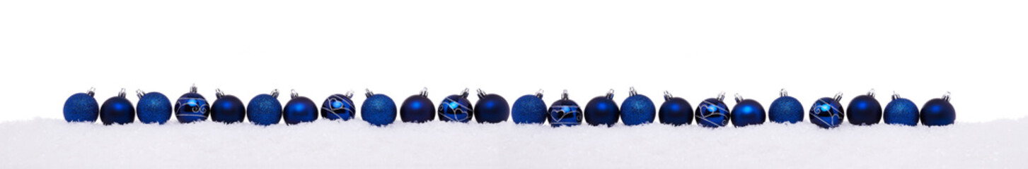 Blue christmas balls in a row isolated on snow, Christmas decoration