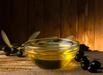 bowl  with olive oil on the wooden table