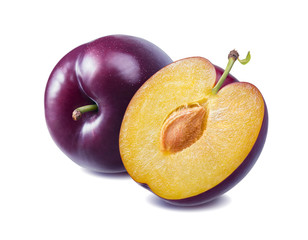 Fresh purple plum and half isolated on white background