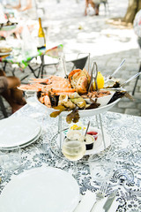 Plate with fresh assorted seafood in french summer restaurant