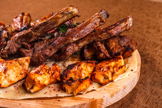 Juicy barbeque pork ribs and dry chicken wings with glaze. Snacks for beer
