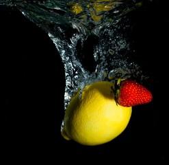 Strawberry with Lemon Splash on Black Background