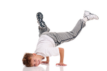 Happy little hip hop dancer - boy dancing isolated on white background. Young white b-boy dancing...