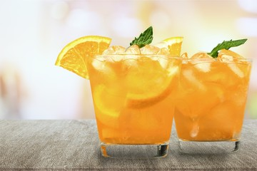 Two glasses of lemonade on blurred background