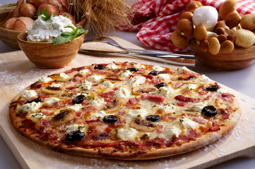 Pizza with ham, mushrooms and black olives