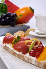 Bread toast with orange, apple, strawberry, cheese, blueberry and raspberry