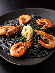Black spaghetti with shrimps, ginger and sesame seeds