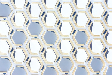 Geometric open metal pattern with white tilted hexagonal shapes