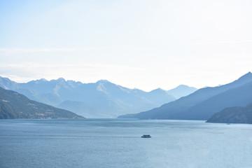 Lonely ferry cruising on Lake Como