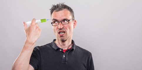 man applies a neurotoxin into his eyebrow looking directly to the syringe