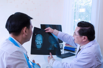 The doctor is diagnosing the patient. x-ray