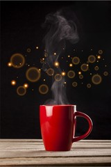 Red hot cup of coffee on black