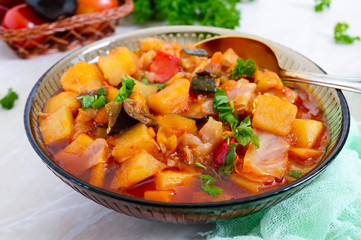 Delicious vegetable stew in a glass bowl. A popular dish of many countries of the world. Vegetarian menu