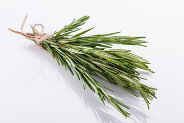 Rosemary essential oil on a white background