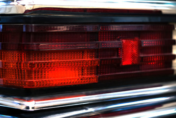 fragment of the backlight of a black vintage luxury car..
