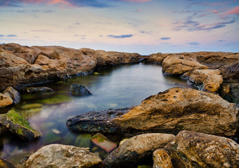 A small bridge on the rocks of Silema bay in Malta