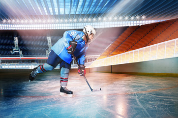 Hockey player passing the puck at ice stadium
