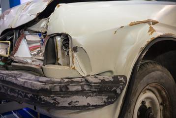 Close up shot of damaged car. Front damage