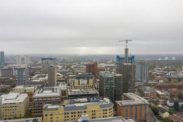 Photo sur Plexiglas Londres Birmingham city centre with construction crane and tall office buildings.