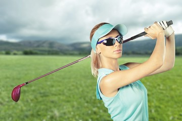 Young happy Caucasian woman with golf club